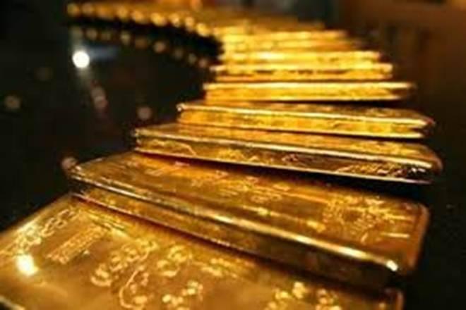 作为美元帽子收益紧缩的金色;投资者等待商品